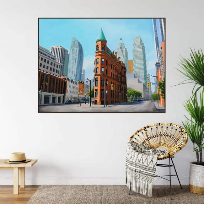 Flatiron Building or Gooderham in Toronto painting shown on a wall
